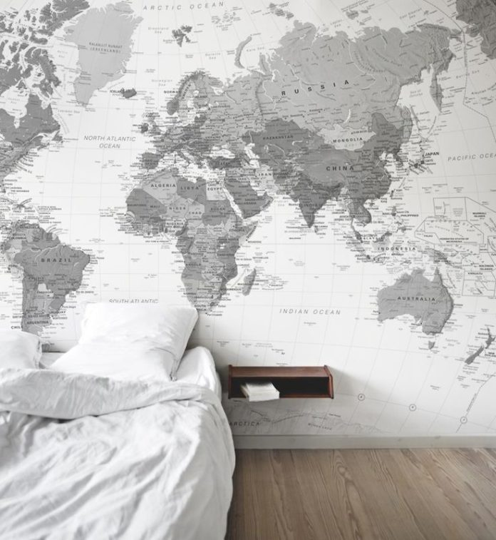 This black and white map wallpaper gives a clean aesthetic to this stylish bedro...
