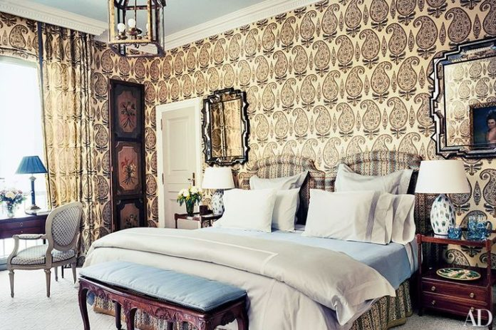 A Jasper paisley hemp is used for the curtains and wall covering in the Barcelon...
