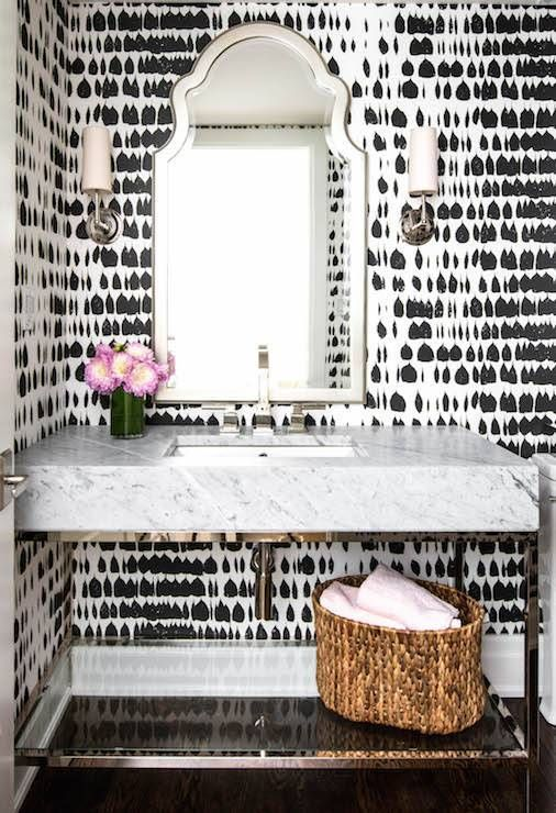 Glam Powder Room With Printed Black And White Wallpaper A Silver Mirror Fl