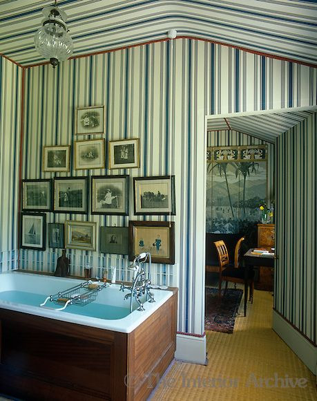 This bathroom and adjacent dressing room have been decorated in an Empire-style ...