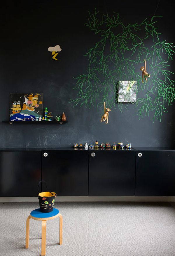 Love the chalkboard paint wall with the green organic wall art (which I have, od...