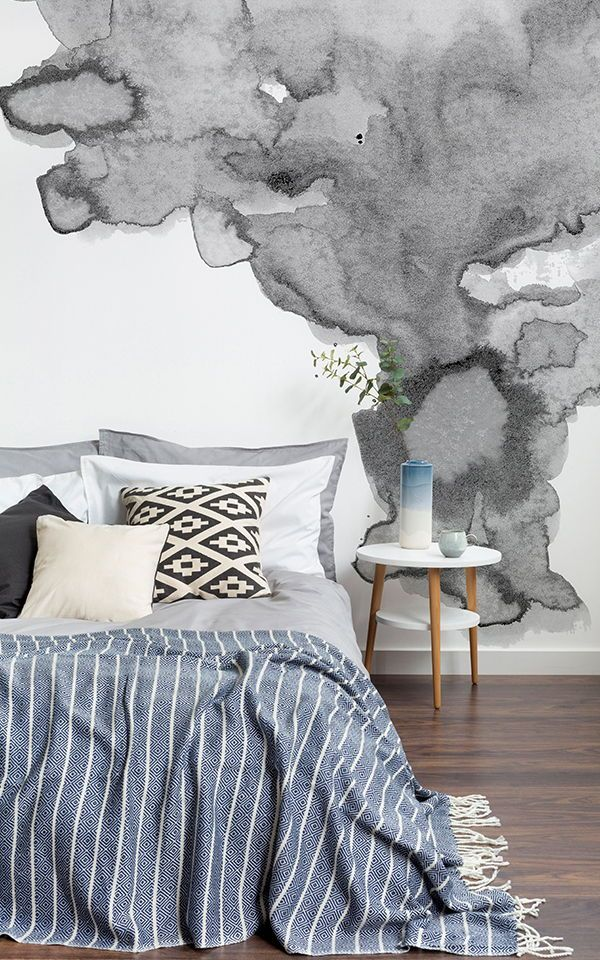 A grey wallpaper mural is key to creating a modern space. Layering lighter and d...