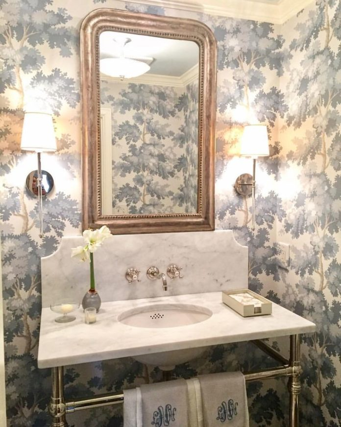 "A recently completed jewel box of a powder room, wrapped in ""Raphael"" wallpa..."