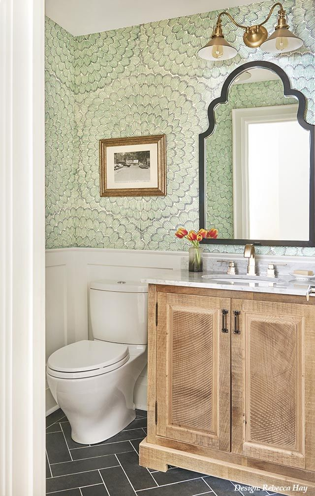 This small main floor powder room was outdated with an over-sized vanity which t...