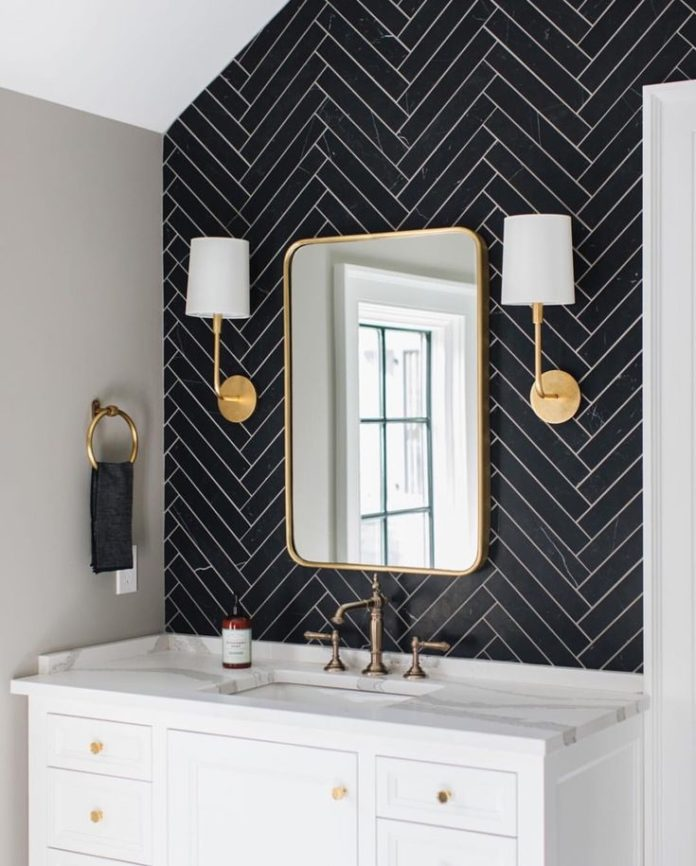 Removable wallpaper or peel and stick tile on one wall.